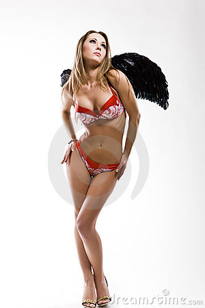 Attractive slim woman in lingerie with black wings