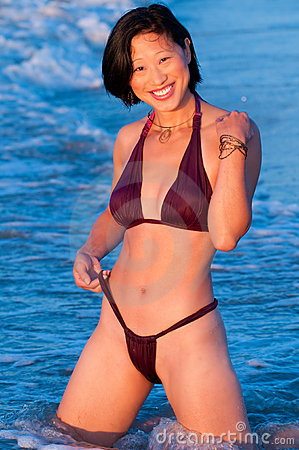 Free Attractive Smiling Asian Woman In Bikini Royalty Free Stock Images - 12594629