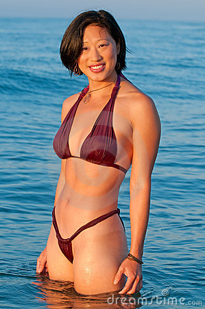 Free Attractive Smiling Asian Woman In Bikini Royalty Free Stock Images - 12595899