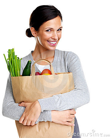 An attractive smiling woman holding a grocery bad