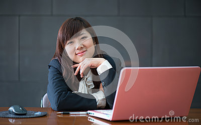 Attractive smiling young business woman