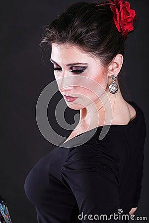 Attractive spanish woman dancing flamenco
