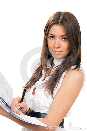 Attractive student holds notepad and pen in hand