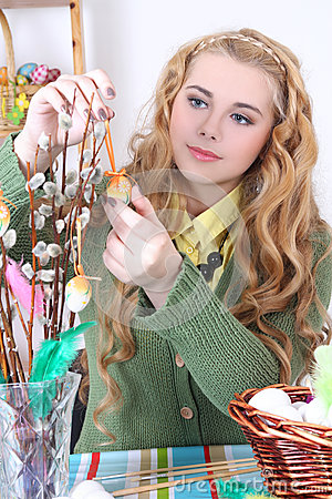 Attractive teenage girl with easter eggs and pussy-willow
