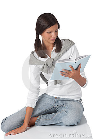 Attractive teenager reading book