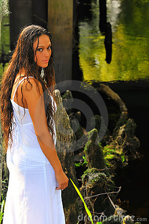 Attractive wet woman by river