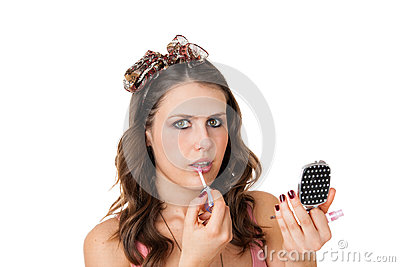 Attractive woman applying lip gloss