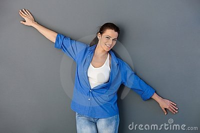Attractive woman with arms wide open