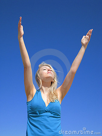 Attractive woman on the blue sky