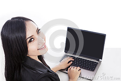 Attractive woman buying online with laptop