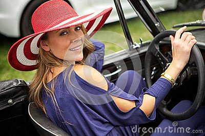 Attractive woman in classic car