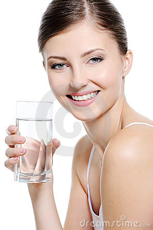 Attractive woman with a clean glass of water