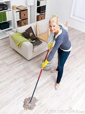 Attractive woman cleaning in her house