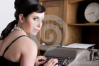 Attractive woman/clerk with typewriter - retro