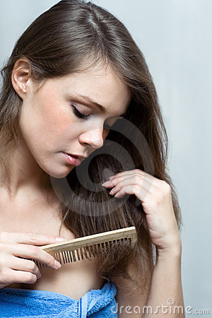 Attractive Woman Combing Her Hair Royalty Free Stock Photos - Image: 12686458