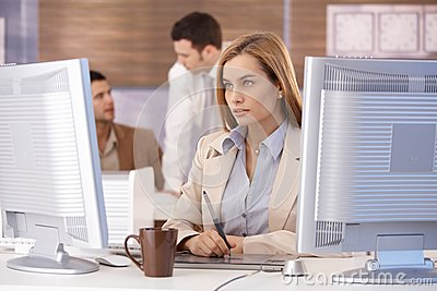 Attractive woman at computer training course