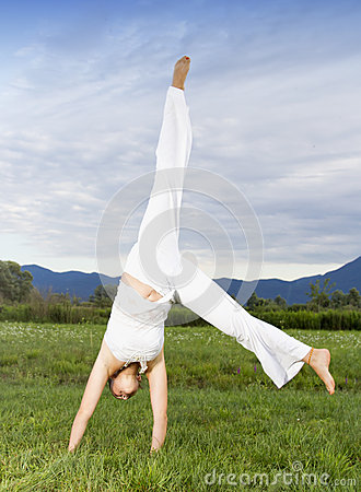 Attractive woman doing cartwheel
