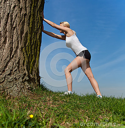Attractive woman doing stretching exercise outside