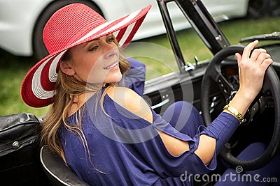 Attractive woman driving a classic car
