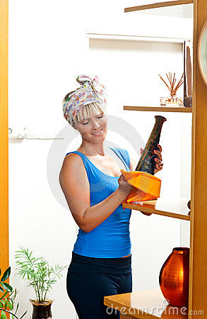 Attractive woman dusting