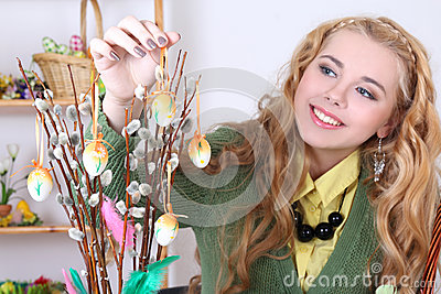 Attractive woman with easter eggs and pussy-willow