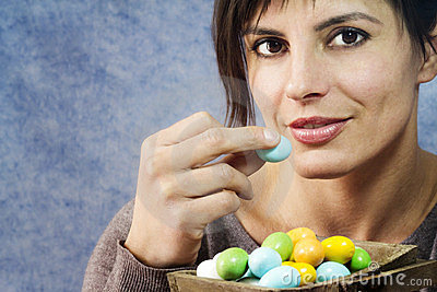 Attractive woman eating easter eggs
