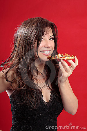 Attractive woman eating pizza