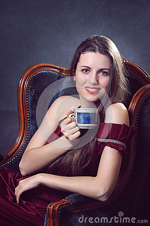 Elegant woman with cup of coffee