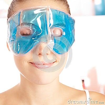Attractive woman enjoying eye mask