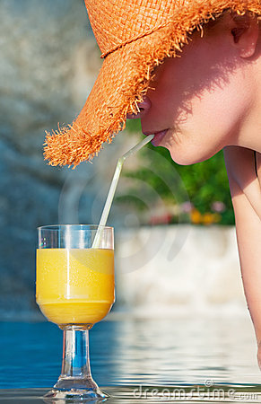 Free Attractive Woman Enjoys Cool Drink By The Pool Stock Photos - 16009023