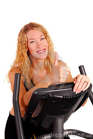 Attractive woman on exercise bike