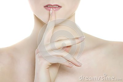 Attractive woman with finger at her lips