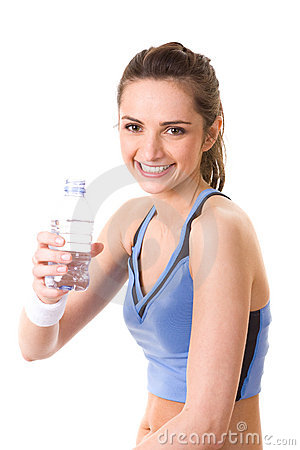 Attractive woman in fitness top holds water bottle