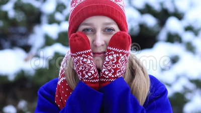 Attractive woman freezing outdoors in winter stock footage
