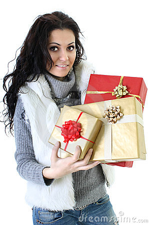 Attractive woman in fur vest with presents
