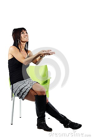 Attractive woman gesturing to her left sitting dow