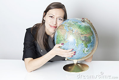 Attractive woman with a globe