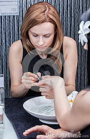 Attractive woman having a manicure at the salon