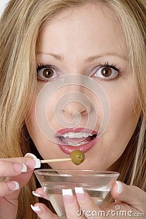 Attractive woman having a martini