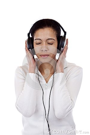 Attractive woman with headphones listens to music
