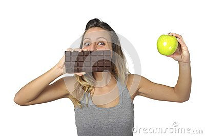 Attractive woman holding apple and chocolate bar in for Food bar hands