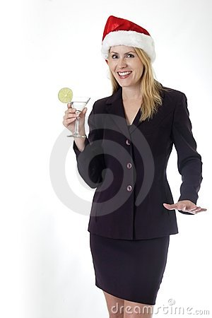 Attractive woman holding a martini at office Christmas party
