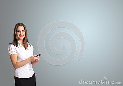 Attractive woman holding a phone with copy space