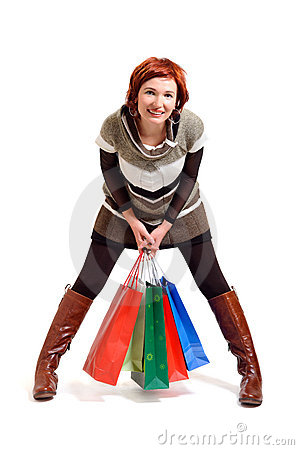 Attractive woman holding shopping bags