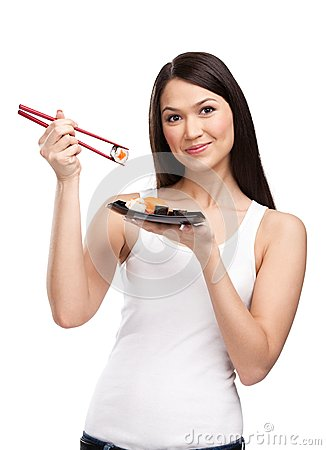 Attractive woman holding sushi roll