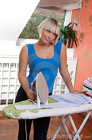 Attractive woman ironing