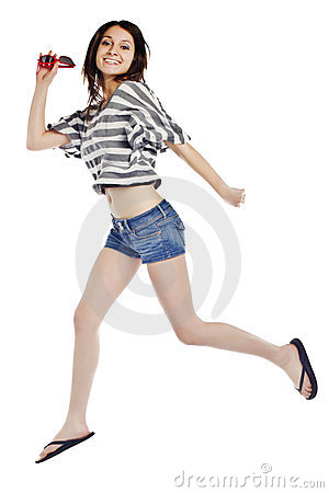 Attractive woman jumping against white background.
