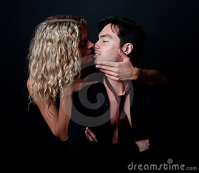 Attractive woman kissing her boyfriend
