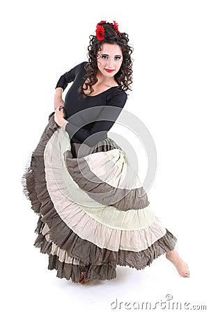 Attractive woman in long skirt dancing