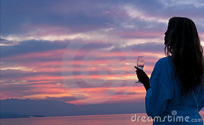 Attractive woman looking at beautiful sunset